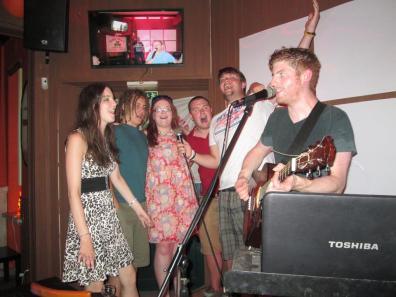 Yes, that is karaoke. It's Hey Jude...